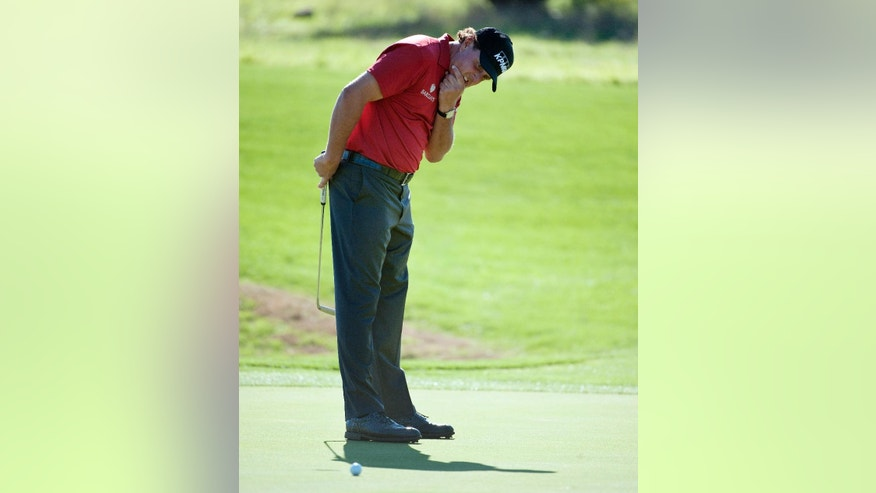 Phil Mickelson reacts to a missed putt on the 15th green during the second round of the Valero Texas Open golf tournament, Friday, March 27, 2015, in San Antonio. (AP Photo/Darren Abate)