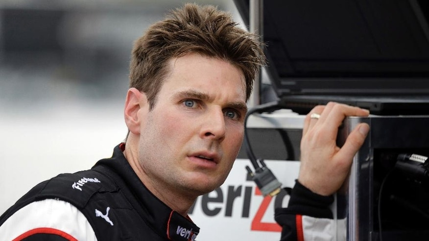 Will Power, of Australia, talks to crew members after practice for the IndyCar Firestone Grand Prix of St. Petersburg auto race Friday, March 27, 2015, in St. Petersburg, Fla. The race takes place on Sunday. (AP Photo/Chris O'Meara)