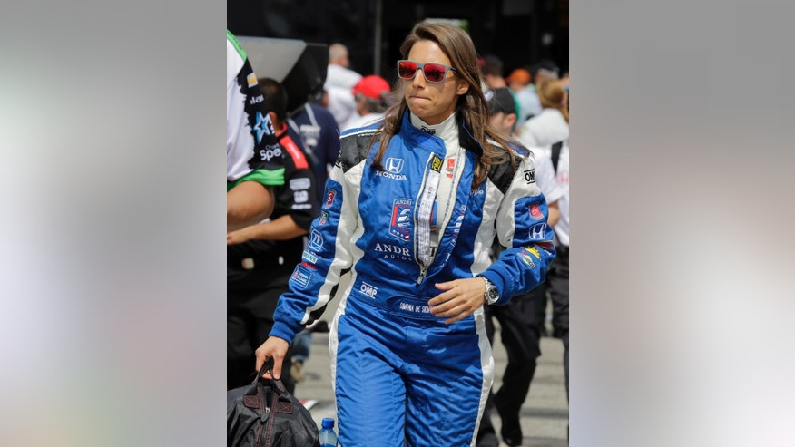 Simona de Silvestro, of Switzerland, walks to her car before practice for the IndyCar Firestone Grand Prix of St. Petersburg auto race Friday, March 27, 2015, in St. Petersburg, Fla. The race takes place on Sunday. (AP Photo/Chris O'Meara)