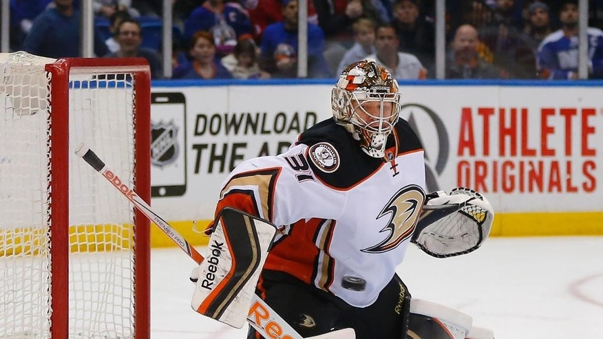 Anaheim Ducks goalie Frederik Andersen (31) stops a shot in the second period of an NHL hockey game against the New York Islanders, Saturday, March 28, 2015, in Uniondale, N.Y.  (AP Photo/Paul Bereswill)