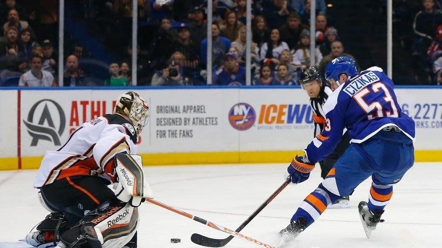 New York Islanders center Casey Cizikas (53) is stopped on a breakaway by Anaheim Ducks goalie Frederik Andersen (31) in the second period of an NHL hockey game Saturday, March 28, 2015, in Uniondale, N.Y.  (AP Photo/Paul Bereswill)