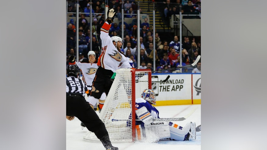 Anaheim Ducks left wing Patrick Maroon (19) celebrates scoring a goal in the first period of an NHL hockey game as New York Islanders goalie Michal Neuvirth (30) sits on the ice Saturday, March 28, 2015, in Uniondale, N.Y.  (AP Photo/Paul Bereswill)