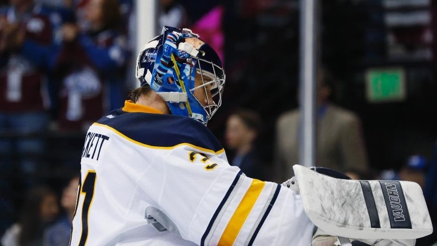 Buffalo Sabres goalie Matt Hackett reacts after giving up a goal to Colorado Avalanche center Matt Duchene in the second period of an NHL hockey game Saturday, March 28, 2015, in Denver. (AP Photo/David Zalubowski)