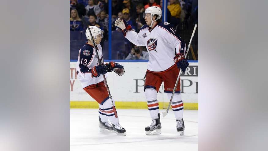 Columbus Blue Jackets' Cam Atkinson, left, is congratulated by teammate Ryan Johansen after scoring during the third period of an NHL hockey game against the St. Louis Blues, Saturday, March 28, 2015, in St. Louis. The Blue Jackets won 4-2. (AP Photo/Jeff Roberson)