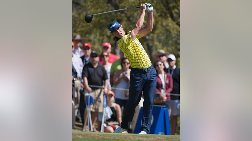 Billy Horschel hits off the first tee during the third round of the Valero Texas Open golf tournament, Saturday, March 28, 2015, in San Antonio. (AP Photo/Darren Abate)