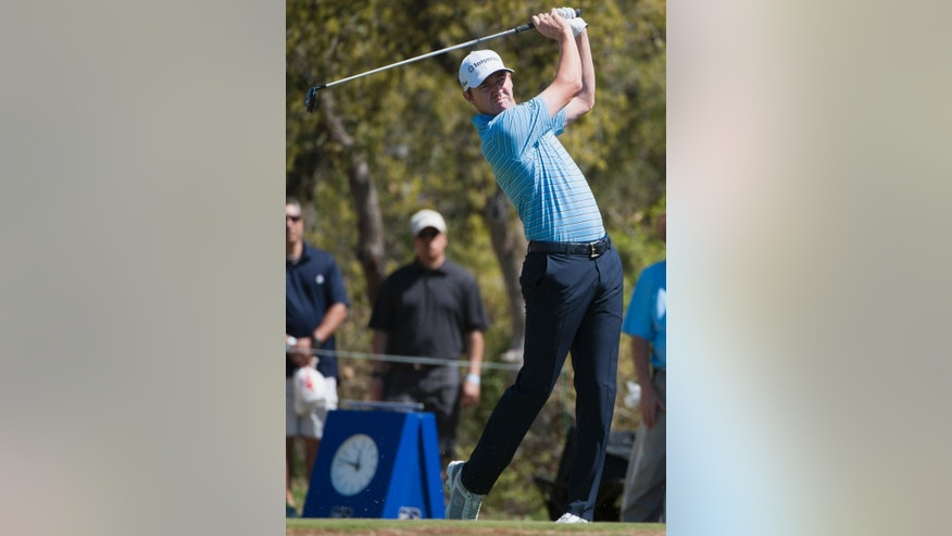 Jimmy Walker hits from the first tee during the third round of the Valero Texas Open golf tournament, Saturday, March 28, 2015, in San Antonio. (AP Photo/Darren Abate)