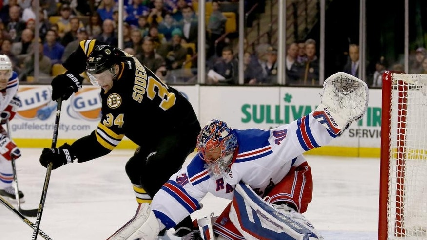 New York Rangers goalie Henrik Lundqvist (30) makes a save on a shot attempt by Boston Bruins center Carl Soderberg (34) during the second period of an NHL hockey game, Saturday, March 28, 2015, in Boston. (AP Photo/Mary Schwalm)