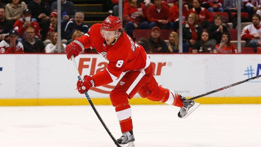 Detroit Red Wings left wing Justin Abdelkader shoots against the Tampa Bay Lightning in the second period of an NHL hockey game in Detroit Saturday, March 28, 2015. Abdelkader scored on the shot. (AP Photo/Paul Sancya)