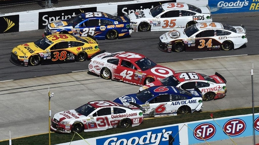 Regan Smith (42) spins out as the field passes by during the NASCAR Sprint Cup auto race at Martinsville Speedway in Martinsville, Va., Sunday, March 29, 2015. (AP Photo/Don Petersen)