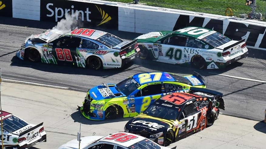 Dale Earnhardt Jr. (88) Landon Cassill (40) Paul Menard (27) and Justin Allgaier (51) tangle during the NASCAR Sprint Cup auto race at Martinsville Speedway in Martinsville, Va., Sunday, March 29, 2015. (AP Photo/Don Petersen)