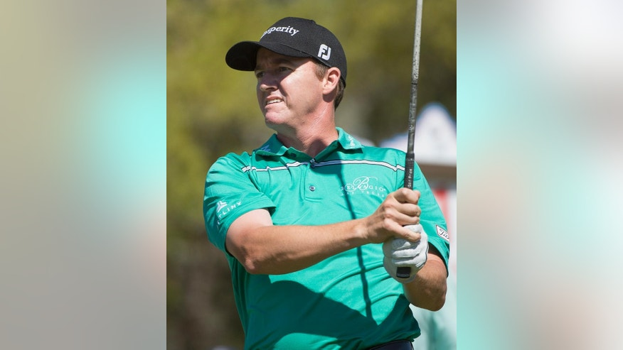 Jimmy Walker watches his drive from the first tee during the fourth round of the Valero Texas Open golf tournament, Sunday, March 29, 2015, in San Antonio. (AP Photo/Darren Abate)