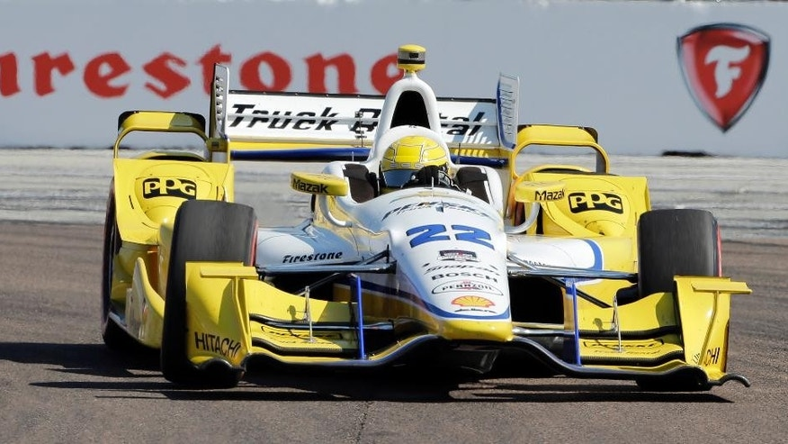 Simon Pagenaud, of France, competes during early running of the IndyCar Firestone Grand Prix of St. Petersburg auto race Sunday, March 29, 2015, in St. Petersburg, Fla.  (AP Photo/Chris O'Meara)