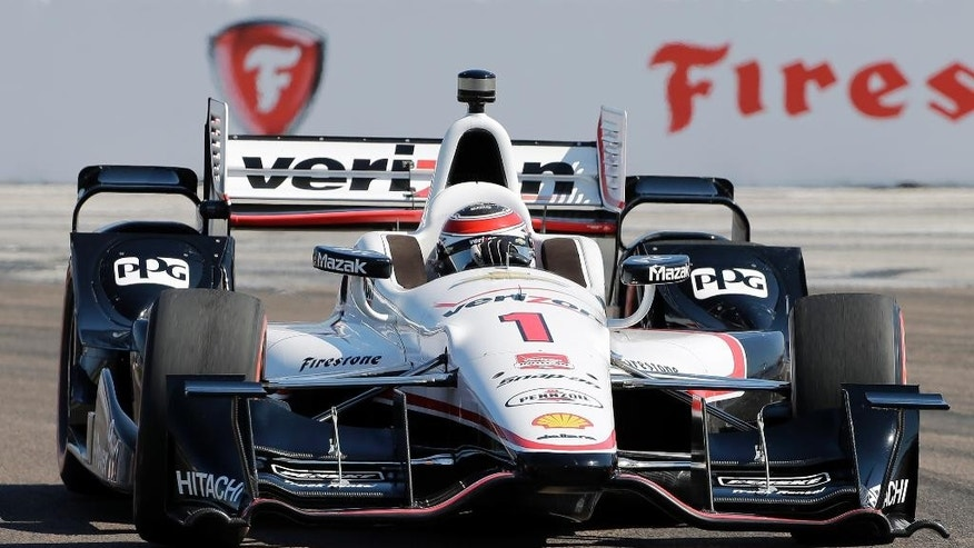 Defending Series champion, Will Power, of Australia, leads during early running of the IndyCar Firestone Grand Prix of St. Petersburg auto race Sunday, March 29, 2015, in St. Petersburg, Fla.  (AP Photo/Chris O'Meara)