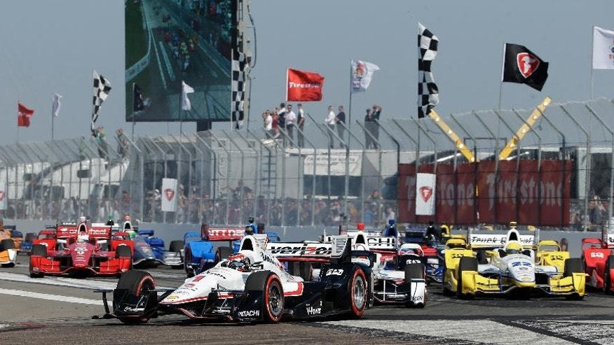 Will Power (1), of Australia, leads the field during the start of the IndyCar Firestone Grand Prix of St. Petersburg auto race Sunday, March 29, 2015, in St. Petersburg, Fla. (AP Photo/Chris O'Meara)
