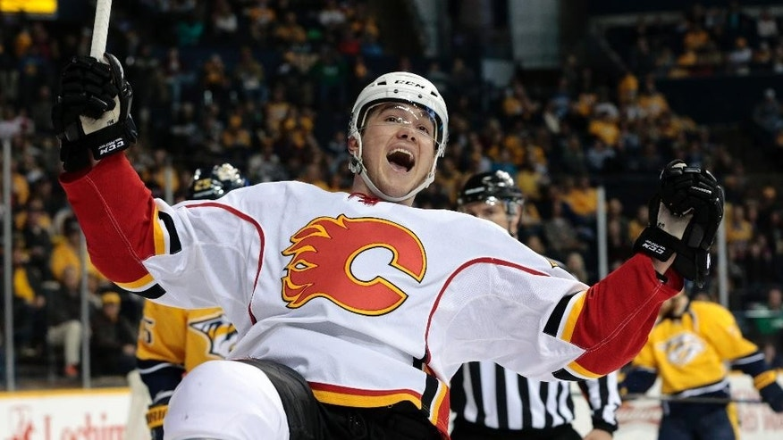 Calgary Flames left wing Michael Ferland celebrates after scoring a goal against the Nashville Predators in the second period of an NHL hockey game Sunday, March 29, 2015, in Nashville, Tenn. (AP Photo/Mark Humphrey)