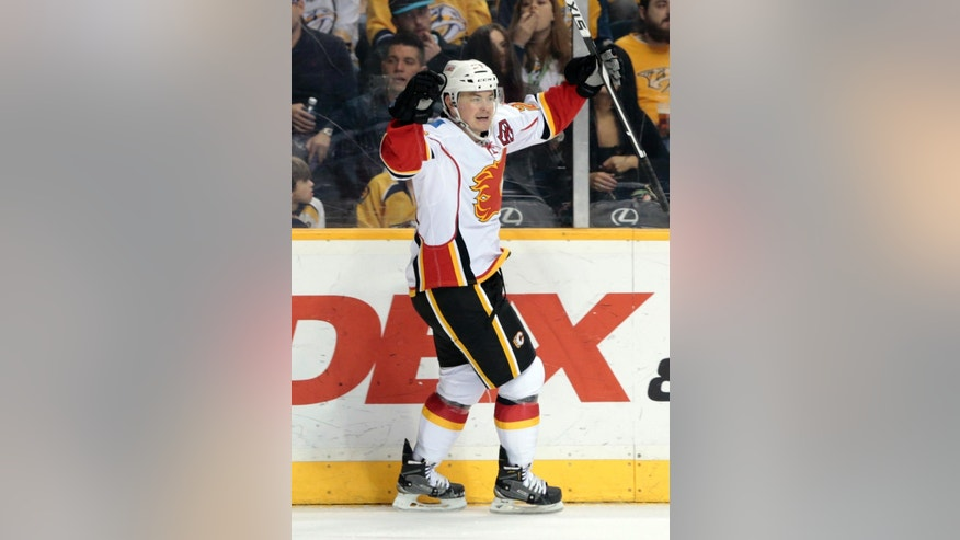 Calgary Flames left wing Jiri Hudler, of the Czech Republic, celebrates after scoring a goal against the Nashville Predators in the second period of an NHL hockey game Sunday, March 29, 2015, in Nashville, Tenn. (AP Photo/Mark Humphrey)