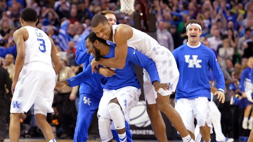 March 28, 2015: Kentucky players celebrate after a 68-66 win over Notre Dame in a college basketball game in the NCAA men's tournament regional finals.