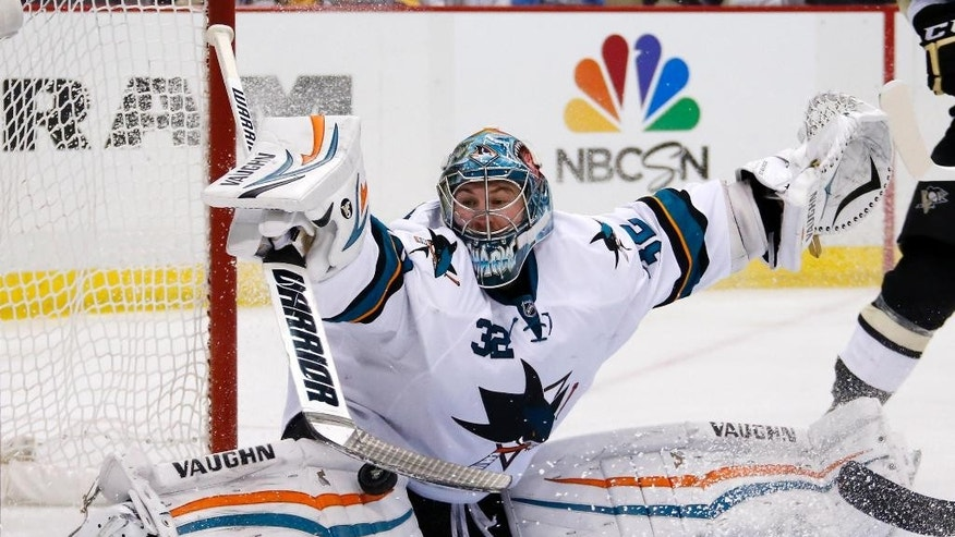 San Jose Sharks goalie Alex Stalock (32) blocks a shot in the second period of an NHL hockey game against the Pittsburgh Penguins in Pittsburgh Sunday, March 29, 2015. (AP Photo/Gene J. Puskar)
