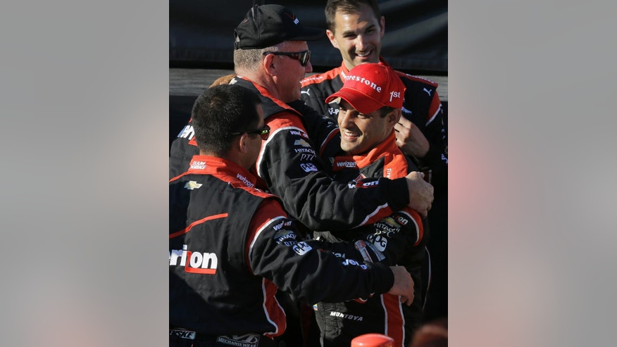 Juan Pablo Montoya, right, of Colombia, celebrates with crew members after winning the IndyCar Firestone Grand Prix of St. Petersburg auto race Sunday, March 29, 2015, in St. Petersburg, Fla.  (AP Photo/Chris O'Meara)
