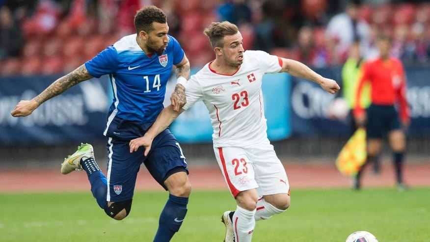 Switzerland's Xherdan Shaqiri, right, challenges for the ball with US' Danny Williams, left, during the friendly soccer match between Switzerland and the US at the Letzigrund stadium in Zurich, Switzerland, Tuesday, March 31, 2015. (AP Photo/Keystone, Ennio Leanza)