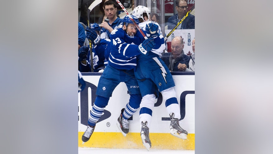 Toronto Maple Leafs Nazem Kadri (43) hits Tampa Bay Lightning's Slater Koekkoek (29) during first period NHL hockey action in Toronto on Tuesday, March 31, 2015.  (AP Photo/The Canadian Press, Nathan Denette)