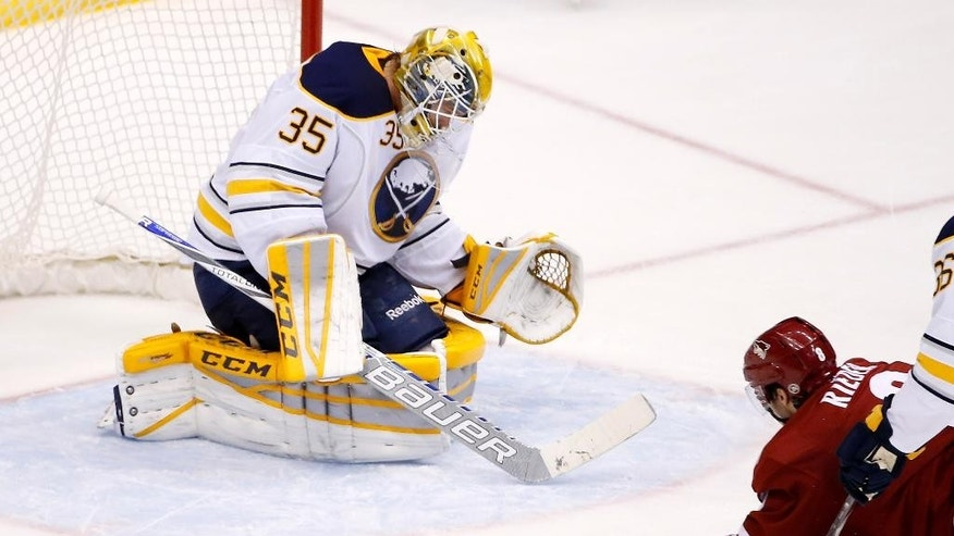 Buffalo Sabres' Anders Lindback (35), of Sweden, makes a save on a shot by Arizona Coyotes' Tobias Rieder (8), of Germany, during the second period of an NHL hockey game Monday, March 30, 2015, in Glendale, Ariz. (AP Photo/Ross D. Franklin)