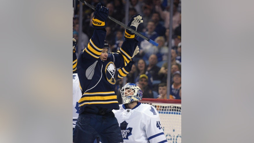 Buffalo Sabres center Zac Dalpe (20) celebrates his goal as Toronto Maple Leafs goaltender Jonathan Bernier (45) reacts during the first period of an NHL hockey game Wednesday, April 1, 2015, in Buffalo, N.Y. (AP Photo/Gary Wiepert)