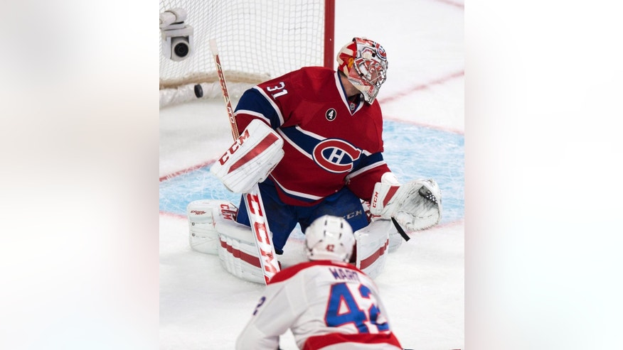Washington Capitals' Joel Ward scores past Montreal Canadiens goalie Carey Price during the second period of an NHL hockey game Thursday, April 2, 2015, in Montreal. (AP Photo/The Canadian Press, Paul Chiasson)