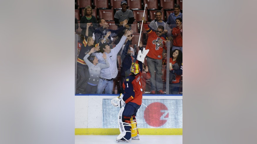 Florida Panthers goalie Roberto Luongo (1) throws his stick into the crowd after an NHL hockey game against the Carolina Hurricanes, Thursday, April 2, 2015, in Sunrise, Fla. The Panthers defeated the Hurricanes 6-1. (AP Photo/Lynne Sladky)