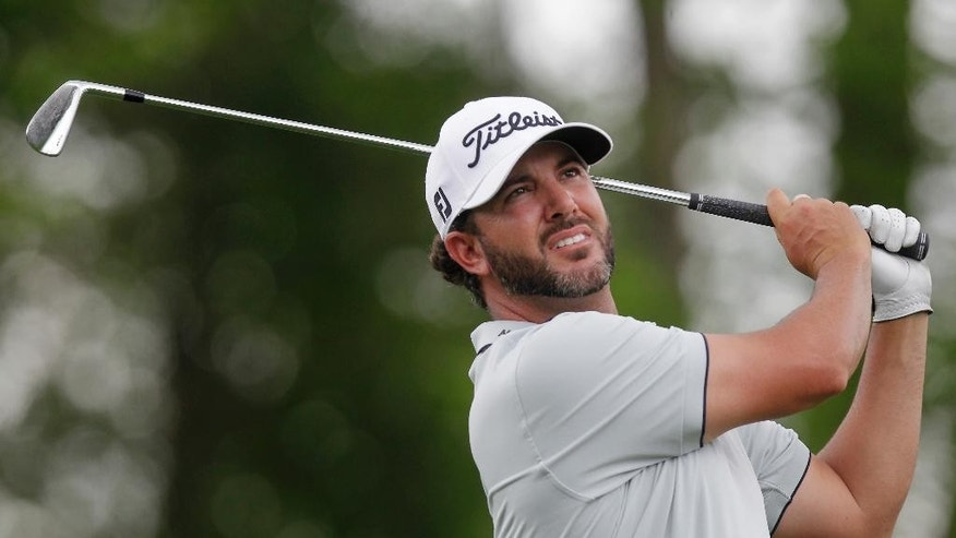Scott Piercy watches his tee shot on the ninth hole at the Houston Open golf tournament in Humble, Texas, Thursday, April 2, 2015. (AP Photo/Patric Schneider)