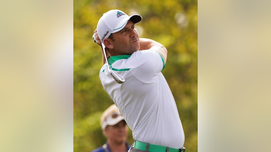 Sergio Garcia, of Spain, watches his tee shot on the 16th hole in the first round of the Houston Open golf tournament on Thursday, April 2, 2015, in Humble, Texas. (AP Photo/George Bridges)