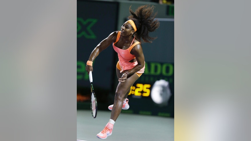 Serena Williams, of the United States, serves to Simona Halep, of Romania, at the Miami Open tennis tournament, Thursday, April 2, 2015, in Key Biscayne, Fla. (AP Photo/Wilfredo Lee)