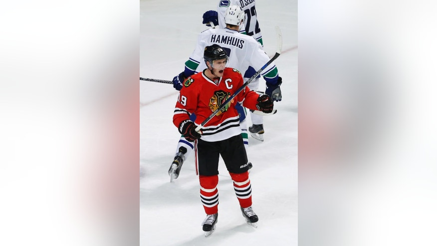 Chicago Blackhawks center Jonathan Toews (19) reacts after scoring against Vancouver Canucks during the third period of an NHL hockey game Thursday, April 2, 2015, in Chicago. The Blackhawks won 3-1. (AP Photo/Kamil Krzaczynski)
