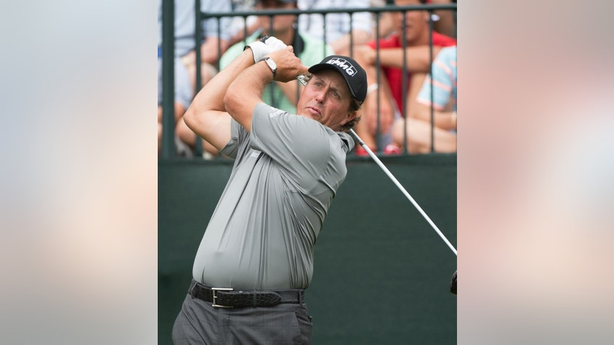 Phil Mickelson hits his tee shot on the first hole in the second round of the Houston Open golf tournament on Friday, April 3, 2015,  in Humble, Texas. (AP Photo/George Bridges)