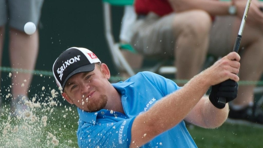 J.B. Holmes blasts out of a bunker on the 18th hole in the second round of the Houston Open golf tournament on Friday, April 3, 2015,  in Humble, Texas. (AP Photo/George Bridges)