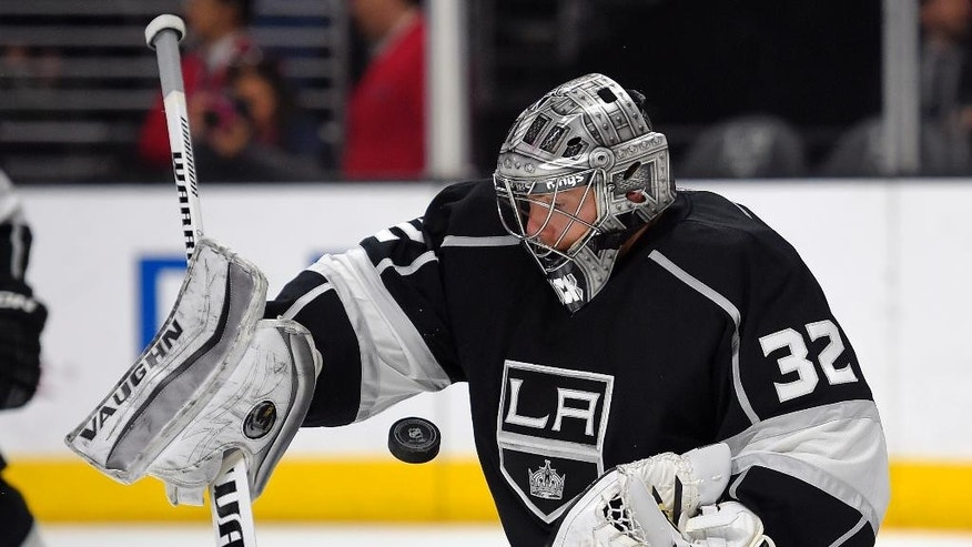 Los Angeles Kings goalie Jonathan Quick deflects a shot during the first period of an NHL hockey game against the Edmonton Oilers, Thursday, April 2, 2015, in Los Angeles. (AP Photo/Mark J. Terrill)