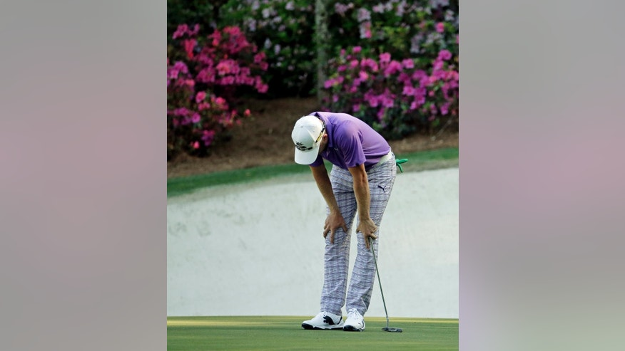 FILE - In this April 12, 2014, file photo, Jonas Blixt, of Sweden, reacts after a bogie on the 13th hole during the third round of the Masters golf tournament in Augusta, Ga. The beauty of the 13th hole at Augusta National goes beyond the 1,600 azalea bushes, which is how it got its name. The genius of the hole can be found in last year's Masters. Of all the par 5s, the 13th produced the most birdies _ and the most bogeys. (AP Photo/Charlie Riedel, File)