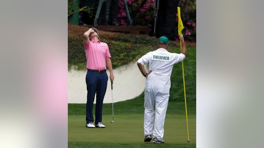 "FILE - In this Sunday, April 14, 2013, file photo, Brandt Snedeker reacts after missing a putt on the 12th green during the fourth round of the Masters golf tournament in Augusta, Ga. No other major produces more drama in the final two hours than Augusta National, which explains the adage that the Masters doesn't start until the back nine on Sunday. ""It's a great feeling to know you have a chance,"" Snedeker said. ""It's also a complete feeling of uncertainty, realizing you've worked your tail off for 63 holes and you're starting over again."" (AP Photo/David Goldman, File)"