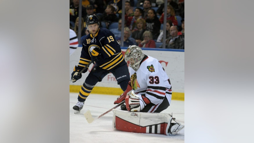 Buffalo Sabres center Cody Hodgson (19) looks for a rebound against Chicago Blackhawks goaltender Scott Darling (33) during the first period of an NHL hockey game Friday, April 3, 2015, in Buffalo, N.Y. (AP Photo/Gary Wiepert)