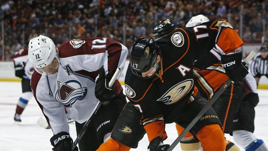 Colorado Avalanche right wing Jarome Iginla, left, battles Anaheim Ducks center Ryan Kesler (17) during the first period of an NHL hockey game in Anaheim, Calif., Sunday, April 3, 2015. (AP Photo/Christine Cotter)