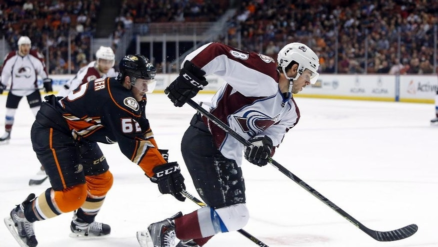 Colorado Avalanche center Joey Hishon, right, controls the puck ahead of Anaheim Ducks right wing Chris Wagner during the first period of an NHL hockey game in Anaheim, Calif., Sunday, April 3, 2015. (AP Photo/Christine Cotter)