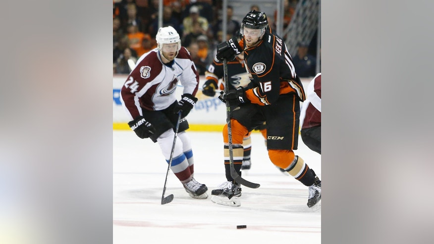 Colorado Avalanche center Marc-Andre Cliche, left, and Anaheim Ducks' Jiri Sekac watch the puck during the second period of an NHL hockey game in Anaheim, Calif., Friday, April 3, 2015. (AP Photo/Christine Cotter)