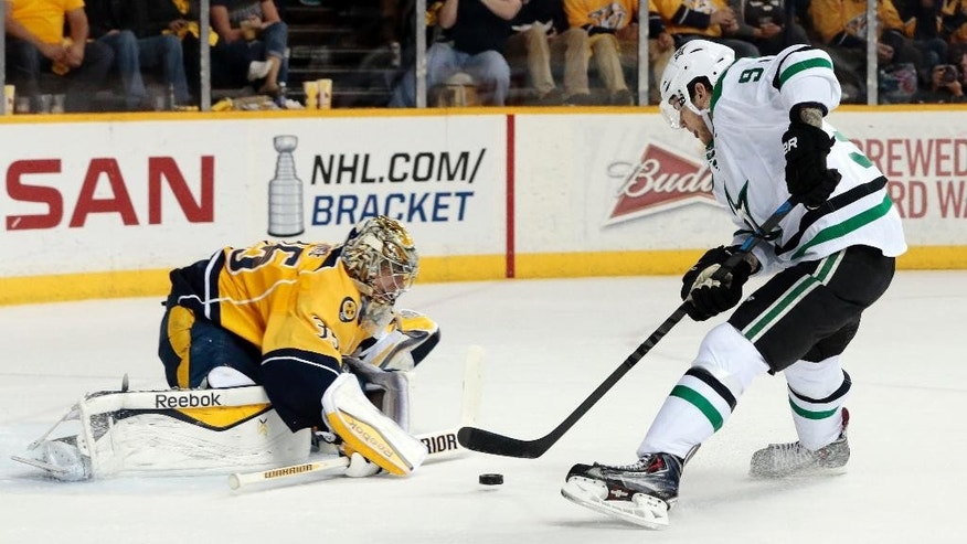 Nashville Predators goalie Pekka Rinne (35), of Finland, blocks a shot by Dallas Stars center Tyler Seguin (91) in the second period of an NHL hockey game, Saturday, April 4, 2015, in Nashville, Tenn. (AP Photo/Mark Humphrey)