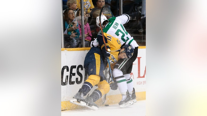 Nashville Predators left wing Taylor Beck (41) battles Dallas Stars defenseman Jordie Benn (24) for the puck in the first period of an NHL hockey game, Saturday, April 4, 2015, in Nashville, Tenn. (AP Photo/Mark Humphrey)