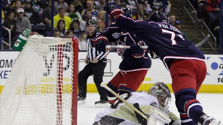 Columbus Blue Jackets' Nick Foligno, right, scores a goal past Pittsburgh Penguins' Marc-Andre Fleury during the second period of an NHL hockey game Saturday, April 4, 2015, in Columbus, Ohio. (AP Photo/Jay LaPrete)