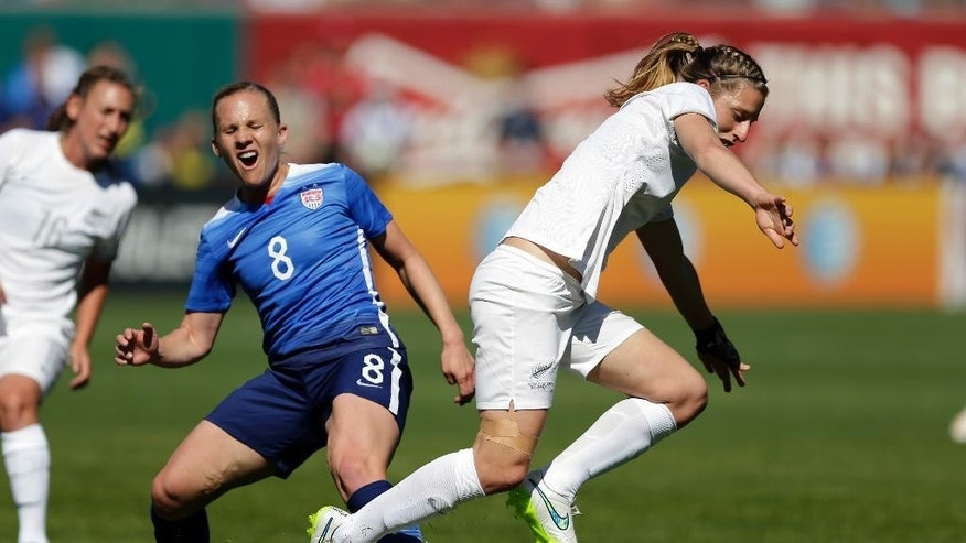 New Zealand's Rebekah Stott, right, steals the ball from United States' Amy Rodriguez (8) during the first half of an exhibition soccer match, Saturday, April 4, 2015, in St. Louis. (AP Photo/Jeff Roberson)