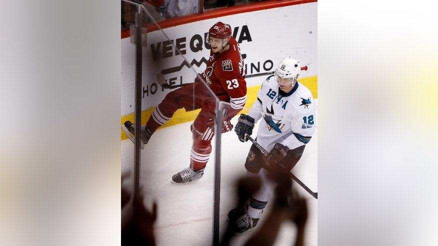 Arizona Coyotes' Oliver Ekman-Larsson (23), of Sweden, celebrates his goal as San Jose Sharks' Patrick Marleau (12)  skates away during the second period of an NHL hockey game Saturday, April 4, 2015, in Glendale, Ariz. (AP Photo/Ross D. Franklin)