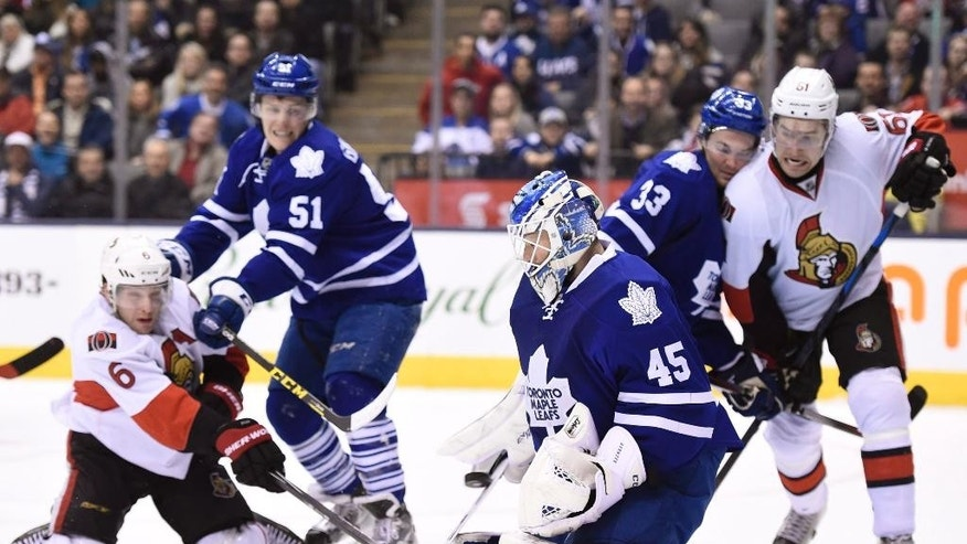 Toronto Maple Leafs' Jonathan Bernier makes a save during the third period of an NHL hockey game against the Ottawa Senators in Toronto, Sunday, April 5, 2015. (AP Photo/The Canadian Press, Frank Gunn)