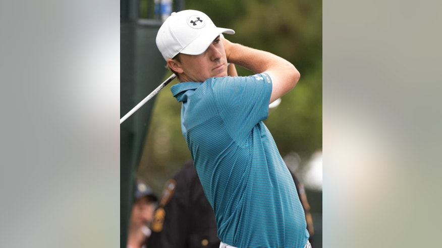 Jordan Spieth watches his tee shot on the first hole in the final round of the Houston Open golf tournament Sunday, April 5, 2015, in Humble, Texas. (AP Photo/George Bridges)