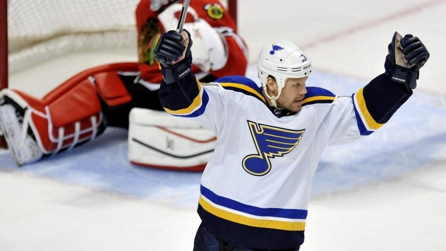 St. Louis Blues' Olli Jokinen (13) of Finland, celebrates after scoring a goal during the second period of an NHL hockey game against the Chicago Blackhawks Sunday, April 5, 2015, in Chicago. (AP Photo/Paul Beaty)